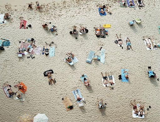 Richard Misrach.  Oversized, overhead beach photos, taking voyeurism to a new level.  But seriously... they're pretty cool in person.