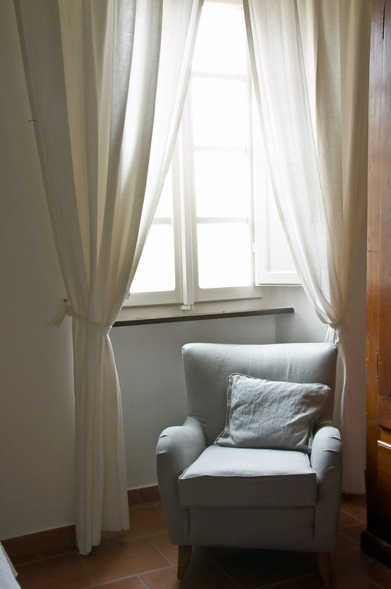 A second life for an old chair; re-upholstered by the Capanni team, with duck-egg Belgian linen by sofa.com.