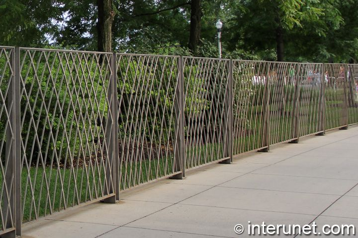 concrete fence | metal fence installed on top of concrete walkway
