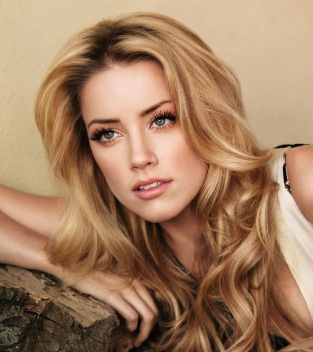 Amber Heard. Flawless makeup aside, she's also dating Johnny Depp...yeah, life's not fair