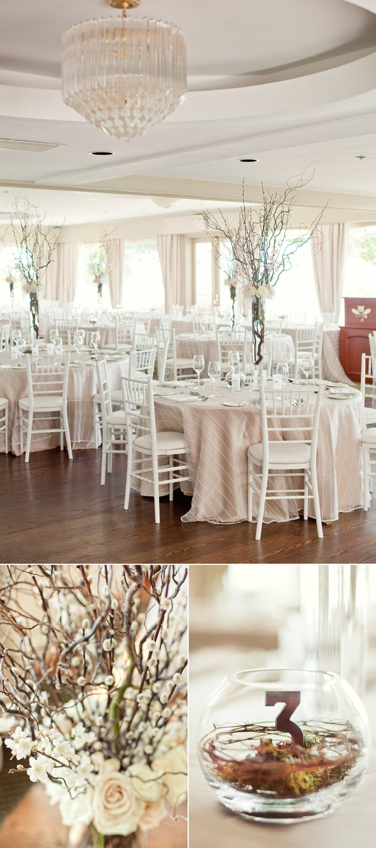 White chiavari chairs, custom linens, centerpieces with ivory and pink roses, curly willow, pussy willow and blossoms. Wooden table numbers nested in willow branches and moss inside of a glass globe. Toronto Hunt