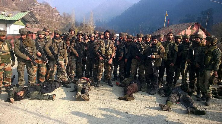 Baramulla: Soldiers present the bodies of the militants who mounted an audacious attack on Indian Army's Field Ordinance Camp at Mohra near the border town of Uri in Baramulla district of Jammu and Kashmir on Dec 5, 2014. (Photo: IANS)