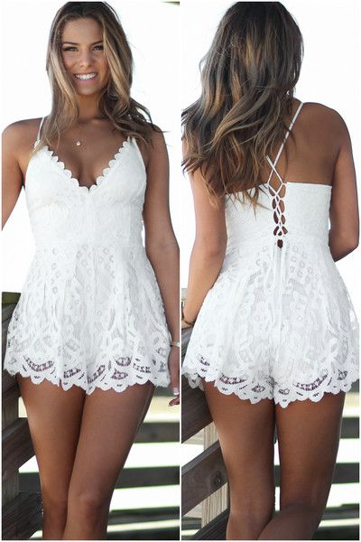 Show off your awesome tan in this bright white romper! Featuring a scalloped neckline and spaghetti style shoulder straps. Criss-cross strap detailing down the