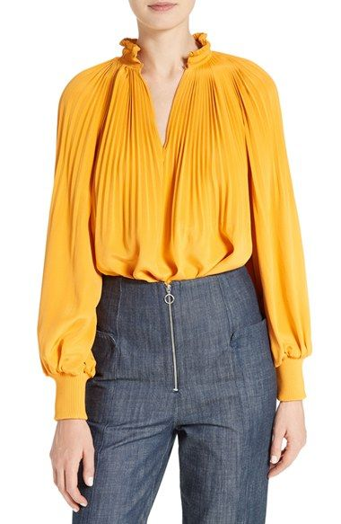 Free shipping and returns on Tibi Edwardian Crêpe de Chine Tunic Top at Nordstrom.com. Fine accordion pleats gathered to a stand collar create Edwardian-era drama for a vibrant silk-crepe top. Rib-knit cuffs rein in the billowy raglan sleeves.