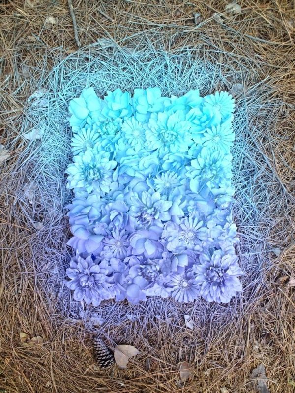 Hot glue fake flowers to a canvas and then pick 2 different color spray paints to add a gradient effect. by vladtodd