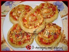 Νόστιμα και γρήγορα ρολάκια σοφολιάτας με τυρί φέτα και ντομάτα, που μπορείτε να εμπλουτίσετε με ότι τραβάει η όρεξη σας.