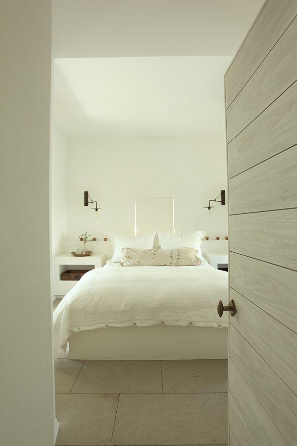 white beach house bedroom, oversize white floor tiles