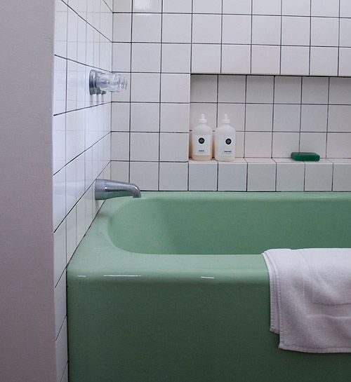 """Amanda Bupp's Catskill s home // Design*Sponge - """"The bathroom tile was inspired by the fall 2011 Balenciaga ad campaign (and maybe a little Flashdance too). The tub and sink were salvaged from an old house upstate"""""""