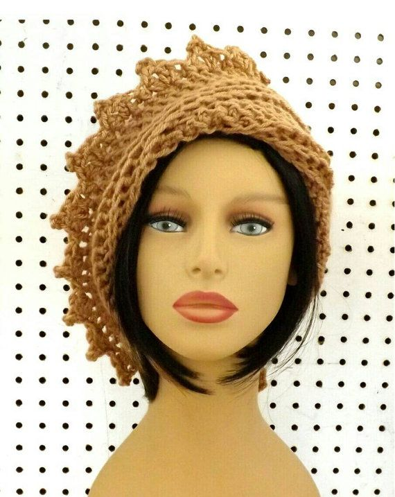 The ageless and timeless LAUREN crochet beanie hat toasted almond with zigzags speaks volumes. Tuck or untuck the left side of the diagonal brim to cover the right or both ears to protect from the cold. It will not fall in your face. Just put it on and change the style with one turn. No need for clasps nor ties. The crown with horizontal ribbed textures cups the head. See other already made LAUREN Crochet Beanie Hats http://etsy.me/21XcsTA  Copy and paste to your web browser to see what each…