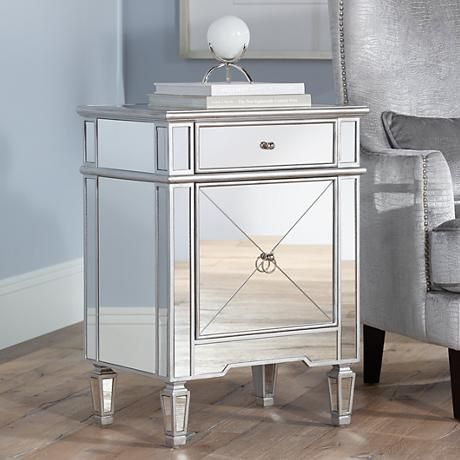 Bring the look of vintage Hollywood to your décor with this luxe mirrored accent table design featuring chrome finish hardware and a beveled table top.