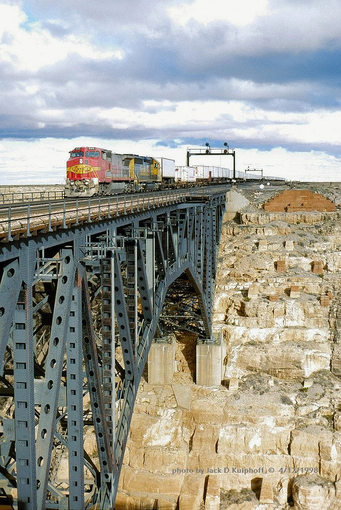 https://flic.kr/p/BzvySu | ATSF 845 w, Canyon Diablo, AZ. 4-12-1998 | AT&SF, Santa Fe, GE C40-8W #845 leading a westbound trailer train over the arched trestle at Canyon Diablo, AZ. 4/12/1998