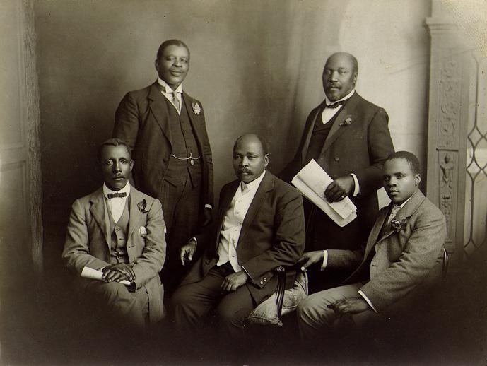 Delegation from the South African Native National Congress that went to   England in 1914 to convey the objections of the African people to the 1913 Land Act.  Back Row (L-R) - Walter Rubusana, Saul Nsane; Front Row - Thomas Mapikela, John Dube, Sol T Plaatje