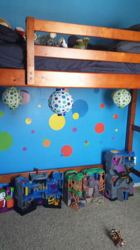 Dollar Tree battery-powered lanterns and removable polka dots create a fun play area under a loft bed.