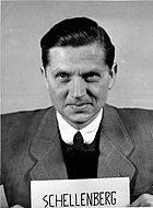 """Walter Schellenberg head of forgein intelligence Germany 1944 He was infamous for his """"office fortress"""" desk which had two automatic guns built into it that could be fired by the touch of a button."""