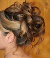 Prom hair??? Bouncy curls woven into a classic updo. Sections of bouncy curls are twisted and woven into a classic updo hairstyle
