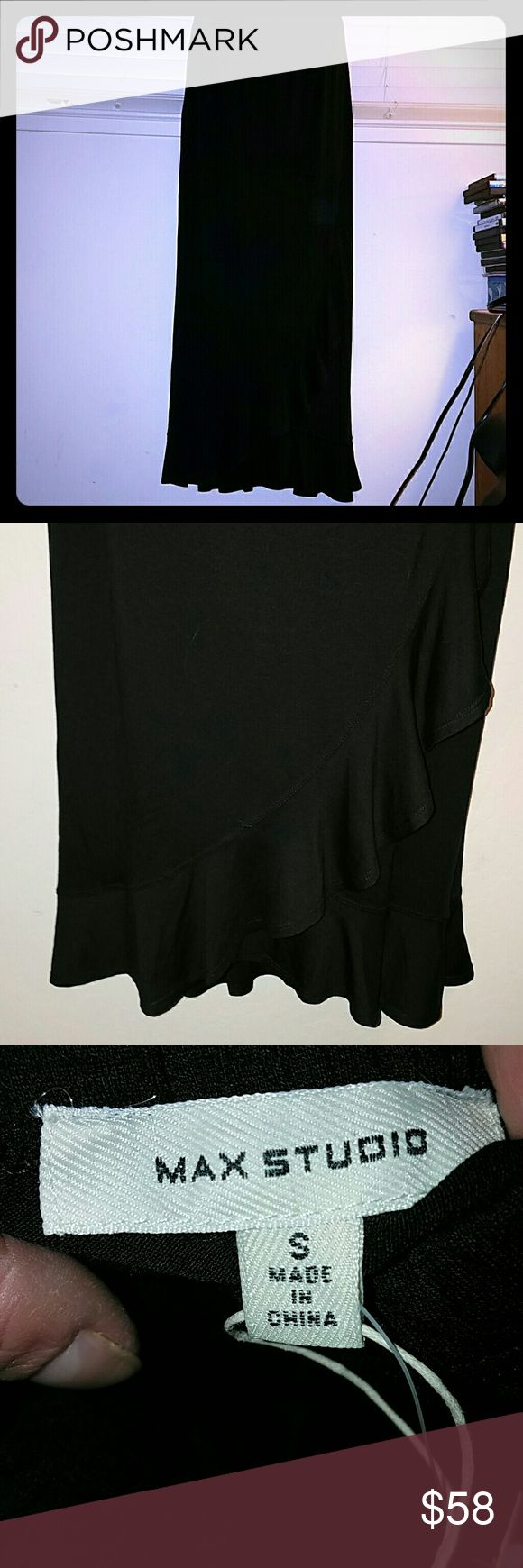 New! NWT! *Black Wrap Maxi Skirt* Black Maxi Skirt that partially wraps around leaving a beautiful flowing asymmetrical line at the bottom (pic #2). Has a stretchy, comfortable waist band. Brand NWT! Max Studio Skirts Maxi