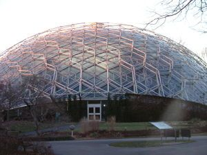 The Climatron is a greenhouse enclosed in a geodesic dome that is part of the Missouri Botanical Garden in St. Louis. Initiated by then Garden director Frits W. Went the dome is the world's first completely air-conditioned greenhouse and the first geodesic dome to be enclosed in rigid Plexiglass (Perspex) panels. Completed in 1960, it was designed by T.C. Howard, of Synergetics, Inc., Raleigh, NC.