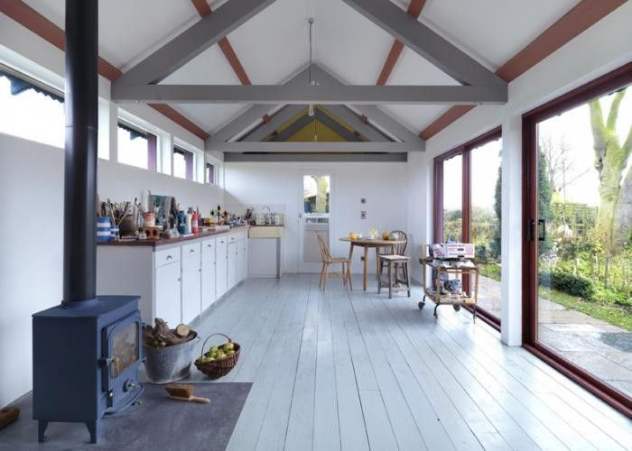 Exposed beams in barn structure and art studio by Threefold Architects | Remodelista