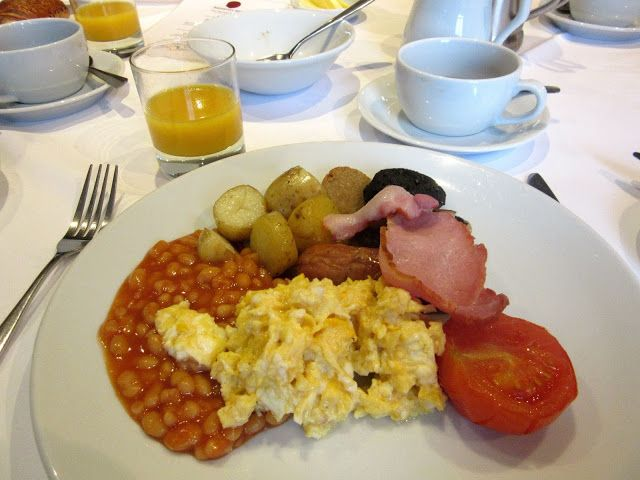 A traditional English breakfast with scrambled eggs, smoked back bacon, sausage, baked beans, sautéed potatoes, plum tomato, black pudding and hog pudding https://destinationfiction.blogspot.ca/2016/10/doc-martins-port-isaac.html