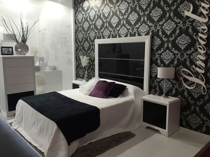 black and white bedroom with a dramatic glossy headboard
