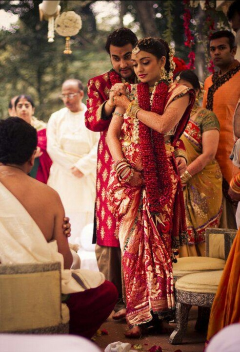 Indian wedding- bride leading the groom around the fire. Love this picture!