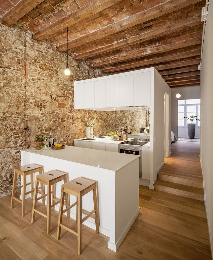 A new home for a lady and her two cats. Like the pic? Follow @frank.arc_ for great b/w architecture pics! Project: Barcelona renovated apartment Design by Sergei Pons Architect Barcelona architect Sergi Pons has exposed stone walls and wooden beams during the renovation of this apartment in the city's Les Corts district. Creating a new home for a lady and her two cats Sergi Pons stripped out all of the partition walls to open up the space and reveal the apartment's original features. He…