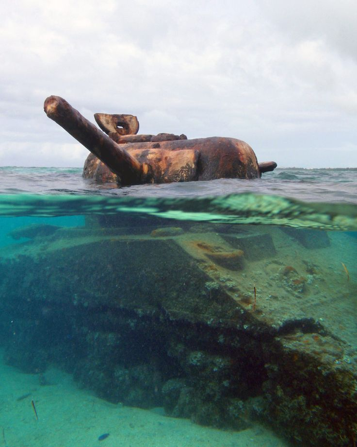 "This Sherman Tank was abandoned in the reef off Garapan beach during the WWII battle of Saipan. It's turret is still trained on the Japanese bunker it was firing at when it got stuck and was abandoned by the crew. Unfortunately this photo had to be taken by my ""pocket"" camera instead of my good camera, because my 7D is not waterproof. Saw this sitting out in the surf and even not having swimming trunks could stop me from immediately jumping in the water and swimming out to it!..."