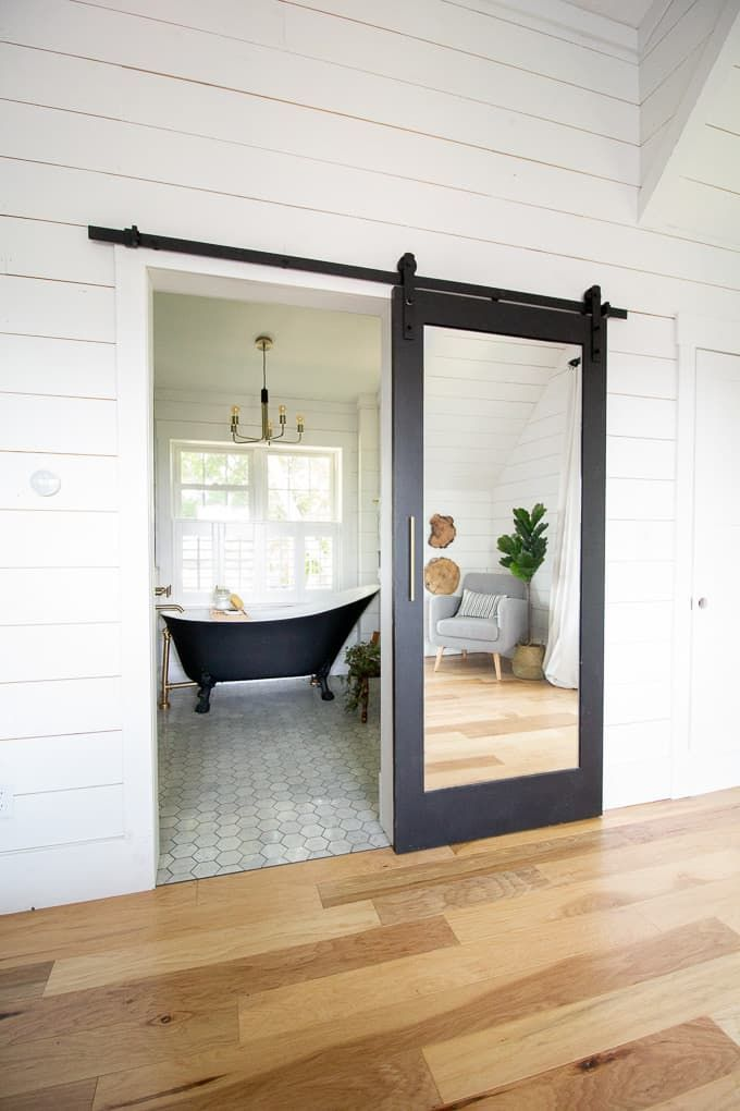 Modern Black And White Bathroom With Brass Accents Barn Door
