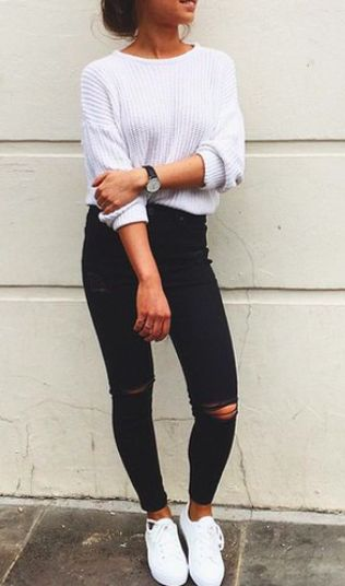 A cute white knitted jumper and pair of black jeans and adidas superstars  triple white.