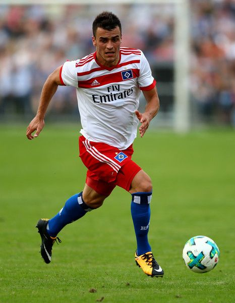 Filip Kostic of Hamburg runs with the ball during the preseason friendly match between Holstein Kiel and Hamburger SV at Gruemmi-Arena on July 19, 2017 in Kiel, Germany.