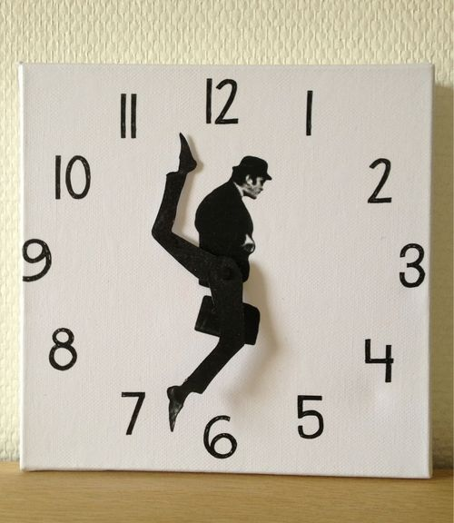 DIY Solve: Monty Python's Ministry of Silly Walks Clock. Take apart any IKEA wall clock, embellish hands and background with scaled and printed cut-outs, re-assemble. OR figure on craft-store clock kit + substrate + numerals. Totally worth it!