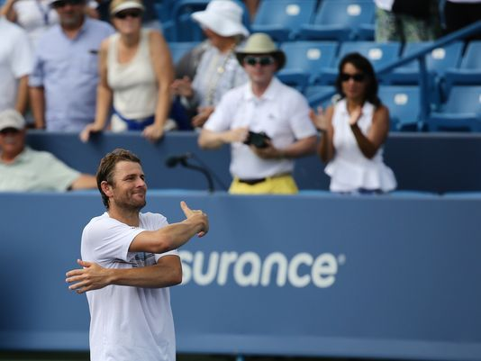 "Wild card Mardy Fish upsets No. 20 Viktor Troicki. Photo: After upsetting Viktor Troicki 6-2, 6-2 at the W&S Open, Mardy Fish showed fans his appreciation for their support with a 'hug."" Fish moves on to play World No. 2 Andy Murray. The Enquirer/Carrie Cochran"