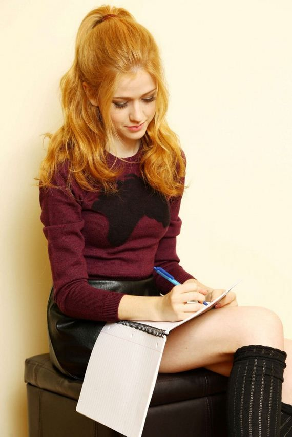*Is sitting in the corner of her bedroom and writing something.* *whispers* I want 2 die. *sighs and tears up*- Katherine
