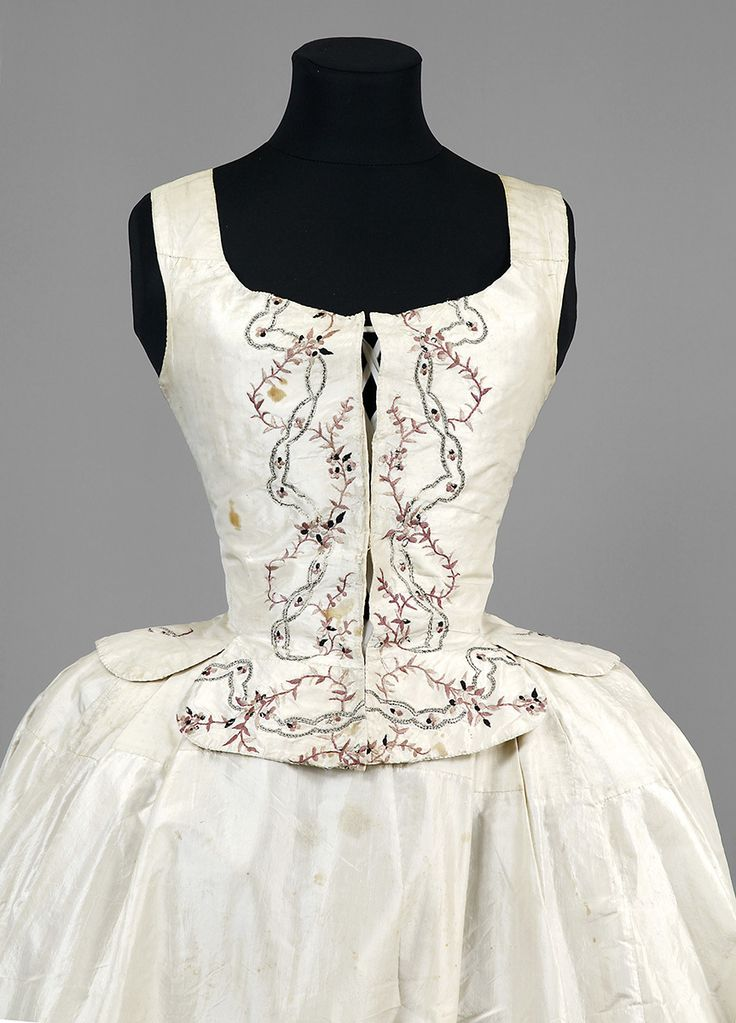 """Jacket, skirt and bodice, Sweden, 1770s. White silk embroidered with floral motifs in purple silk an dsilver thread. Beloged to """"Aunt Ulla"""" Ulrica Christina Cronstedt (1756-1841)."""