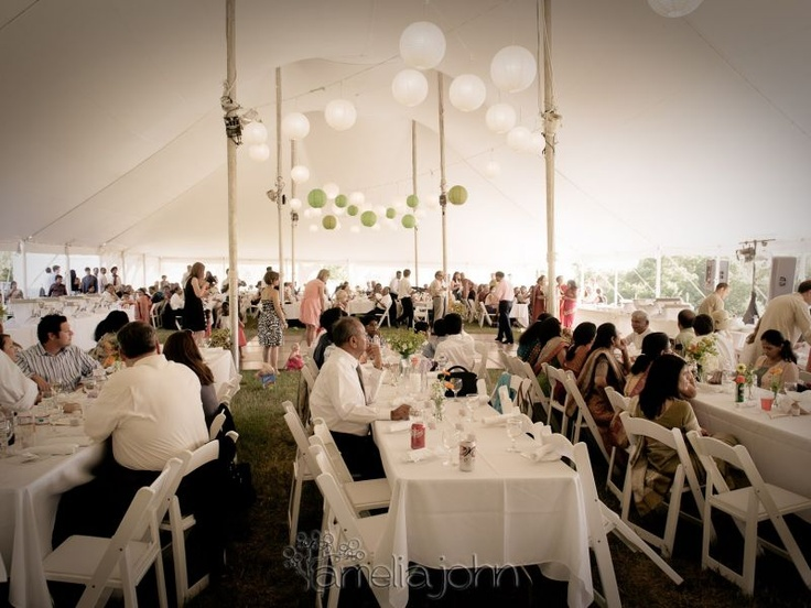 A pole tent filled with happy guests. Plenty of room for tables and a dance floor in the middle. Courtesy of Amelia John Photography.