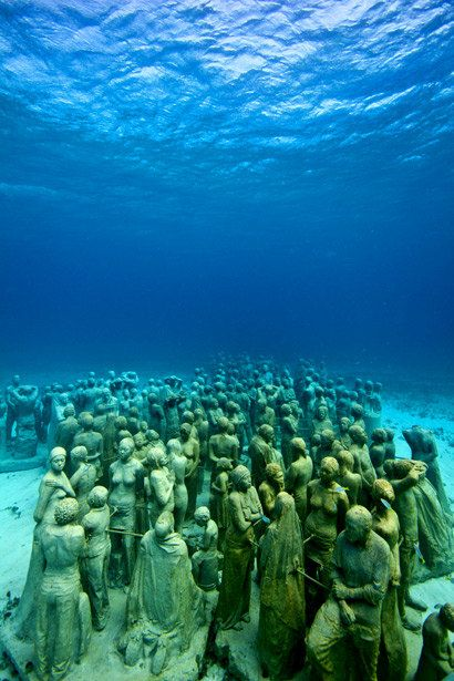 Cancun's underwater museum. neat and creppy at the same time