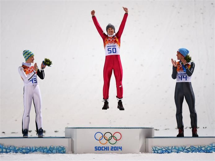 (L-R) Silver medalist Peter Prevc of Slovenia, gold medalist Kamil Stoch of Poland and bronze medalist Anders Bardal of Norway celebrate on the podium during the flower ceremony for the Men's Normal Hill Individual Final | Sochi 2014 Winter Olympics