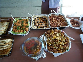 Islamic food has large portions of rice, beans, bread, humus, vegetables, and meats.