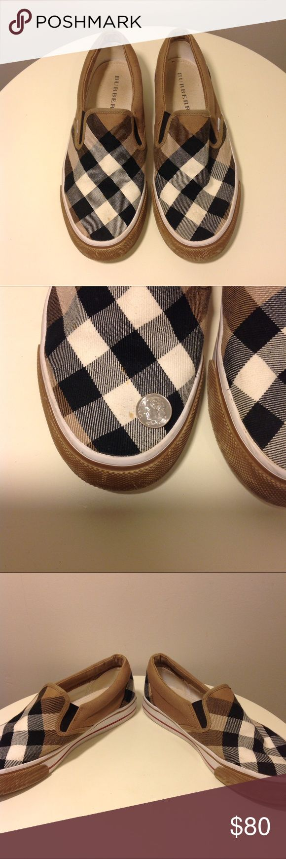 """Burberry Nova Check Canvas Slip-On Sneakers US 8 Burberry Nova Check Canvas Slip-On Sneakers US 8 EU 39  Authentic; good-fair pre-owned condition  Flaws of note: Right Sneaker has small splatter spots on front (see photo with dime) Left sneaker rubber """"Burberry"""" tab on back of shoe broke due to rubbing, but was repaired.  Black, white, beige Burberry Shoes Sneakers"""
