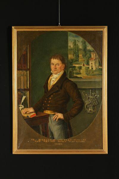"""Olio su tela. Ritrae un nobiluomo identificato dalla dicitura alla base """"Il nobile Giò Fran. Piouani,nato nel 1764 morto li 25 giugno 1834"""" e affiancato dallo stemma di famiglia.In cornice."""