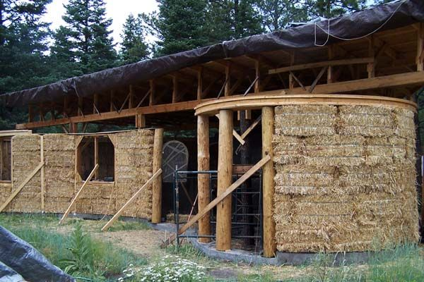 curved straw bale walls raised, straw bale hybrid house, custom design, gentle design, straw bales on edge, passive solar home design, solar gain, insulation