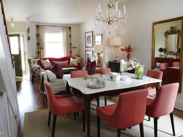 The deep pink couch in the living room is complemented by the light pink chairs in the dining room. Design by Sarah Richardson