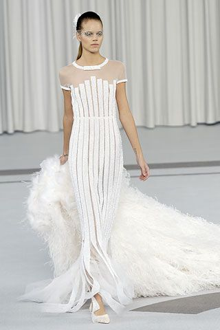 Similar...without organza neck shoulder section and with wild featheriness as detachable train