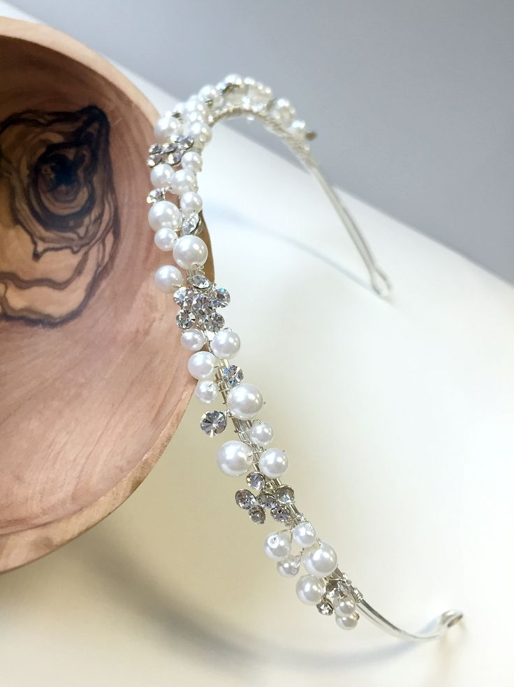 A delicate pearl & rhinestone headband is perfect for the bride who simple and delicate headband.