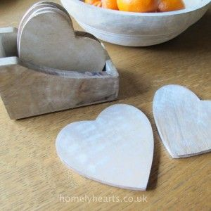 Heart Shaped Coaster Set. Six wooden heart shaped mango wood coasters and a little box to store them in.