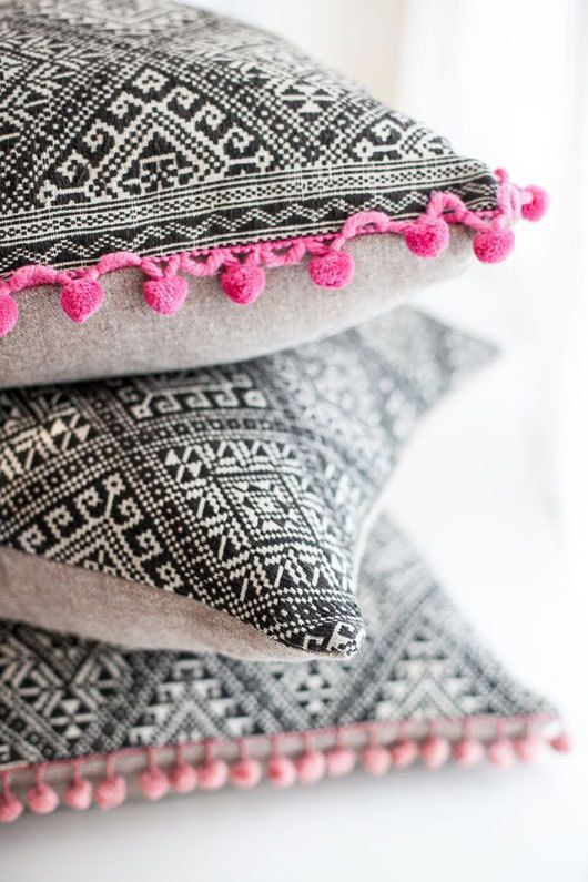 Black and white graphic pillows with colourful pompoms