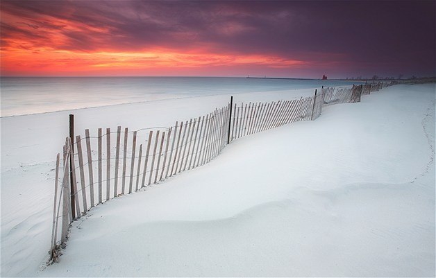 Andrew Le/Getty Images  The sky glows over Lake Michigan near Holland, Mich.                                                                  Andrew Le/Getty Images