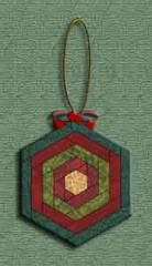 Log Cabin Hexie Ornament   Are you crazy for hexies? And for log cabin patterns? Then here is the perfect little ornament to satisfy both crazies. :) Have fun sewing this little beauty in a jiffy!