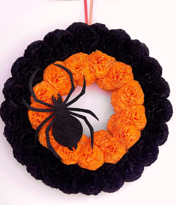 "Add spiderweb and small spider to center. Add either ""trick or treat"" or ""boo"" along right side. Maybe add a ghost or witch. Mainly black roses with a few orange."