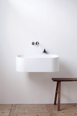 minimal & warm; not always found together (spa water room)